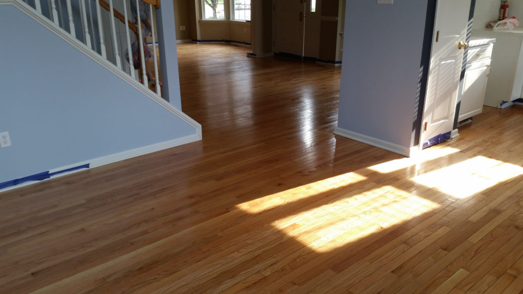 Who Refinishes Hardwood Floors? Here's Why Only Pros Should.